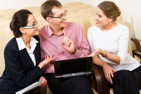 Conversation of three business people at meeting in the conference room  photo