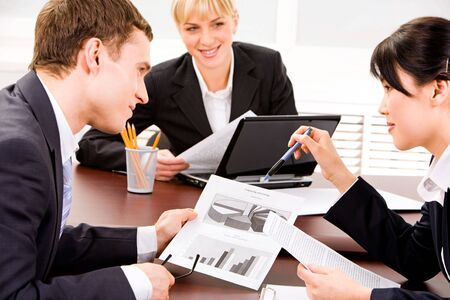 Image of business people planning a new project in a working environment photo
