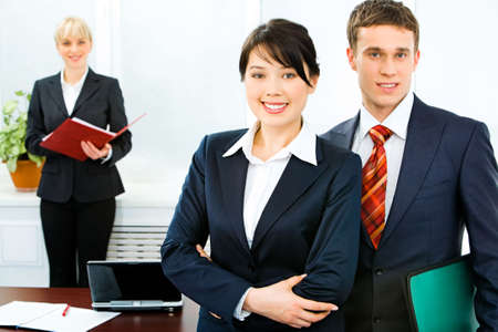 Image of successful business people standing in front Stock Photo - 2644690