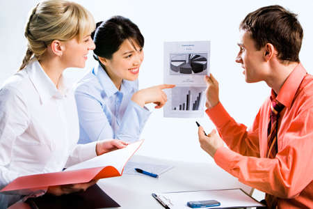 Portrait of confident professionals demonstrating a new plan to the coworker Stock Photo - 2644737
