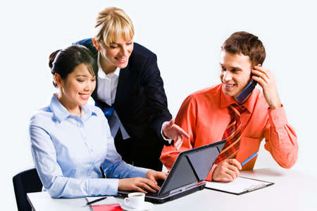 Portrait of three confident business people working  photo