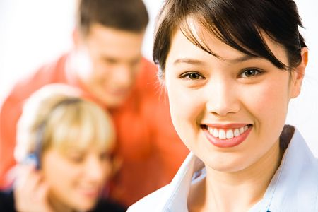 Close-up of pretty professional with charming smile on the background of people photo