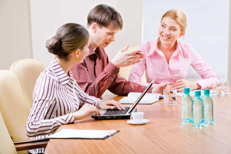Image of business people discussing new ideas in the boardroom  photo