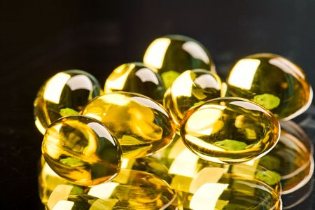 depressant: Photo of yellow transparent capsules on the black background