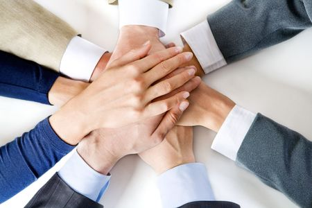 Conceptual image: different human hands on top of each other Stock Photo - 2657519