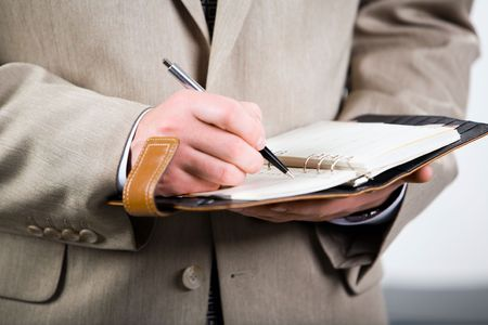 Photo of businessman holding the pen and notepad Stock Photo - 2657530