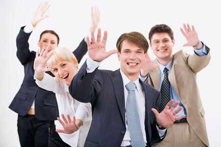 expressing: Portrait of four successful business people expressing joy