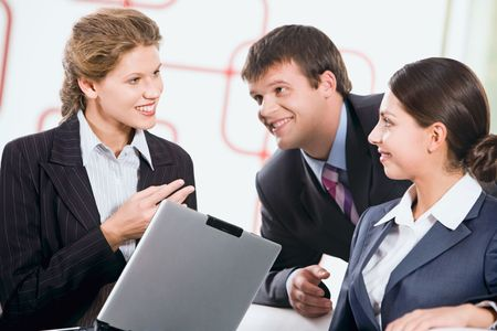 Group of three business people discussing a new plan photo