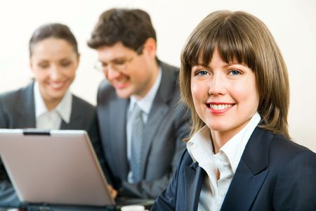 Portrait of smiling businesswoman on the background of two businesspeople Stock Photo - 2725194