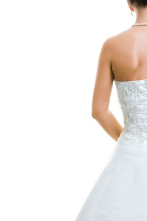feminine background: Image of back of bride in wedding dress isolated on a white background Stock Photo
