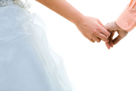 Wedding photo of married couple holding hands photo