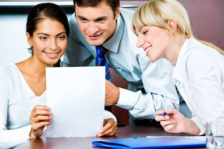 Image of confident business persons looking at the document  photo