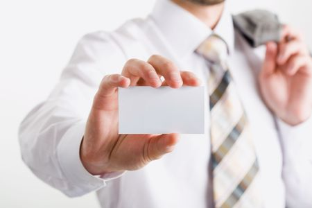 Image of fingers holding a blank business card photo
