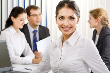 Portrait of young elegant female business leader with charming  smile Stock Photo - 2688367