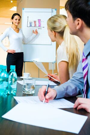 demonstrating: Image of businesswoman demonstrating her project to business partners at seminar  Stock Photo
