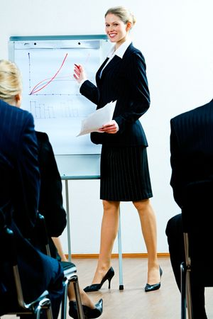 Image of successful woman teaching a business lecture  photo