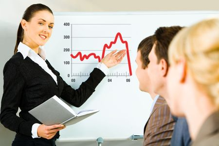 Portrait of confident woman teaching a lecture business people pointing to the diagram photo