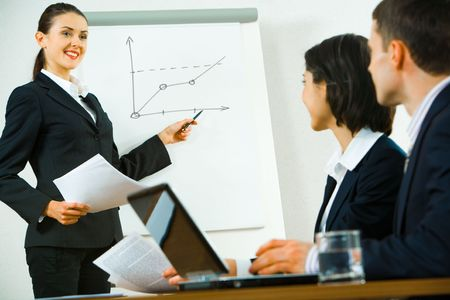 demonstrating: Portrait of confident woman demonstrating her report to colleagues   Stock Photo