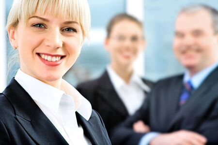 Portrait of self-confident employee in suit on the background of people Stock Photo - 2738287