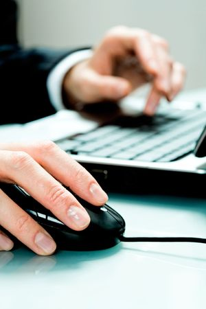 Vertical image of hands pushing keys of a computer mouse and keyboard Stock Photo - 2739866
