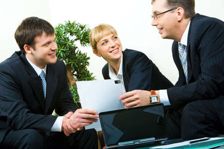 Business man passing the documents to his partner at meeting Stock Photo - 2779513