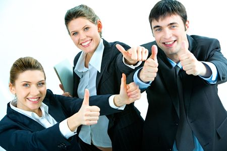 thumbs up man: Image of business people giving the thumbs-up sign Stock Photo