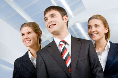 looking away from camera: Image of business group of three perspective people looking away from camera
