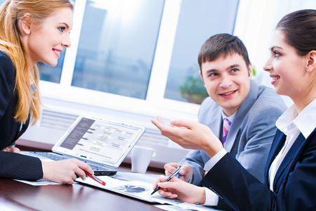 Photo of business people sitting at the table and discussing a new idea Stock Photo - 2779452