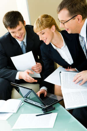 Portrait of three confident business people working together Stock Photo - 2779491