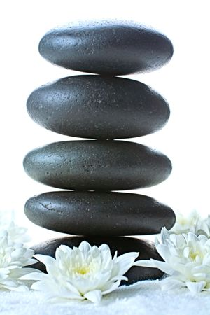 Vertical image of stack of volcanic pebbles photo
