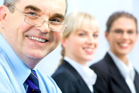 Image of faces of business people with boss in front Stock Photo - 2786260