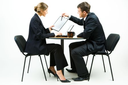 Photo of business man pointing at document held by the woman Stock Photo - 2836838