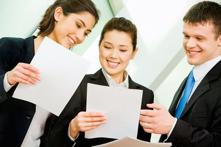 Portrait of three office workers interacting at business meeting  photo