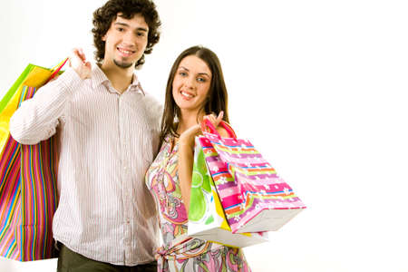 Photo of young couple with the shopping bags on a white background photo