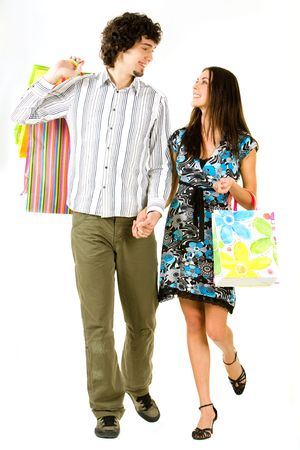 Image of couple holding the bags and hands together walking photo