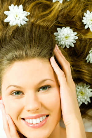 touched: Photo of female�s happy face being touched by her hands looking at camera  Stock Photo