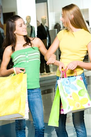 Portrait of two women having a conversation in the shopping mall photo