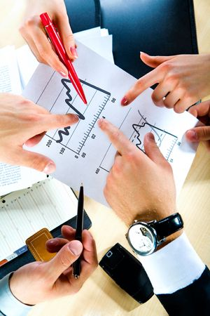 Business people� hands showing the document photo