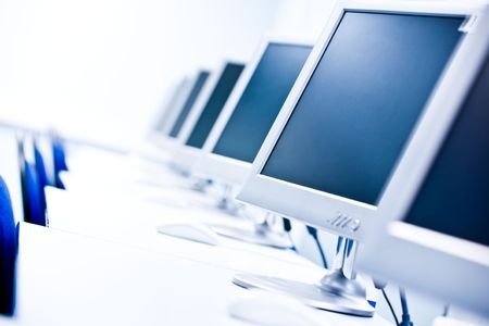 place to learn: Image of empty classroom with computers, tables and chairs in the lines Stock Photo