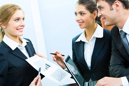 Portrait of confident business woman demonstrating a plan to her colleagues  Stock Photo - 2859782