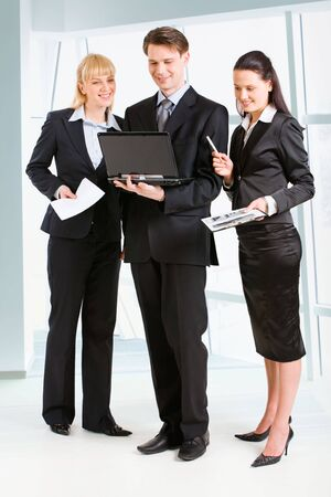 Business people discussing a new plan and standing in the office  Stock Photo - 2885026