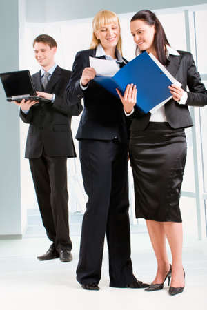 Portrait of business women holding the document and standing in front Stock Photo - 2885031