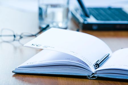 Close-up of notepad with pen placed on the table Stock Photo - 2885028