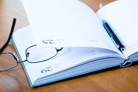Image of glasses, notepad with pen lying on the table Stock Photo - 2885030