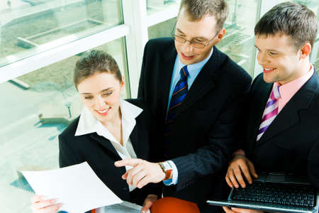 Image of business man showing the document to colleagues  Stock Photo - 2885470