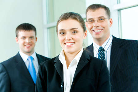 Portrait of pretty leader on the background of business team Stock Photo - 2885034