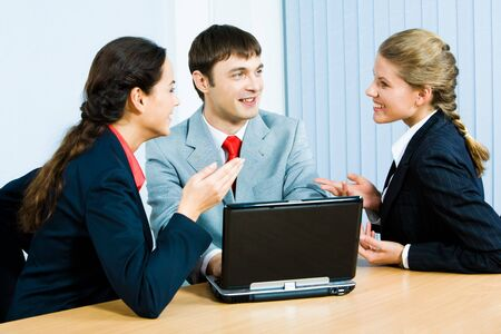 Photo of business ladies and businessman sitting at the table and speaking during business meeting in the office Stock Photo - 2885468