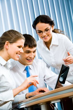 Vertical photo of successful business partners looking at the laptop screen at business meeting in the office Stock Photo - 2885465