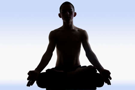Image of man doing yoga on a blue background  photo