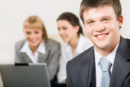 Portrait of confident professional looking at camera in a working environment Stock Photo - 2913189